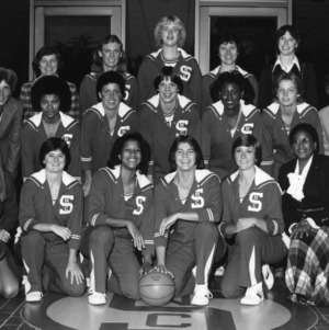 North Carolina State University 1980-1981 women's basketball team posing at the Everett N. Case Athletics Center.