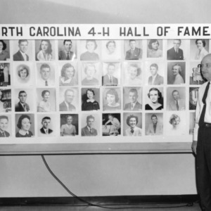 """Members of the North Carolina 4-H Honor Club standing in front of a display reading """"North Carolina 4-H Hall of Fame"""""""