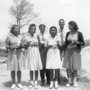 4-H county council officers standing at a council meeting, April 18, 1941