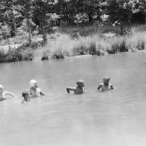 4-H boys and girls enjoying a swim at the Wildlife Camp
