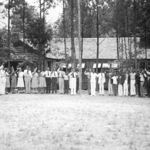 4-H club members reciting the pledge of allegiance at a conference in Wake County, July 14-17, 1941