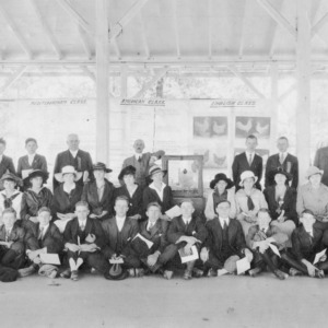 A group of poultry club members of Durham County Club studying, judging under supervision of A. G. Oliver, agent Durham, N.C.