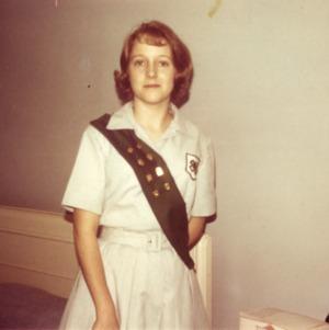 4-H club member wearing a uniform and sash