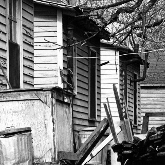 Backs of several rundown homes in Raleigh, NC