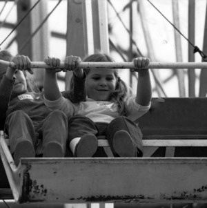 Two little girls on the Ferris Wheel at the North Carolina State Fair