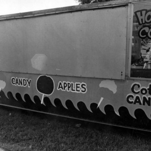 Vendor booth at the North Carolina State Fair selling candy apples, and popcorn