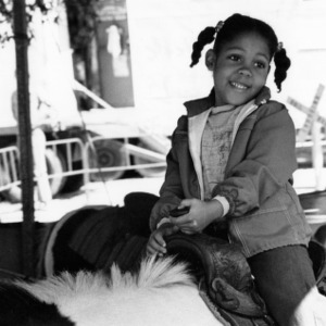 Little girl riding a pony at the North Carolina State Fair