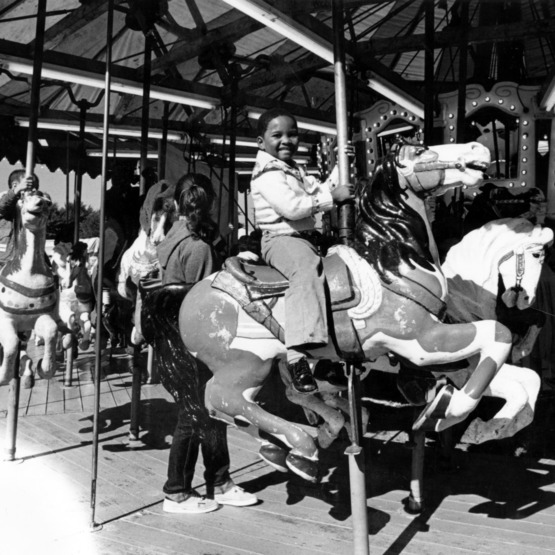 Children riding the merry-go-round at the North Carolina State Fair