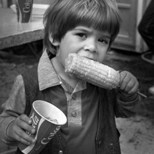 Little boy eating corn on the cob at the North Carolina State Fair