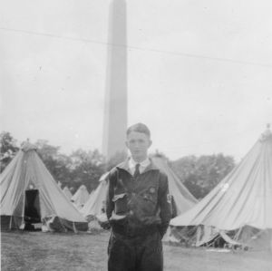 Aaron Peele of Wayne County, North Carolina, with Washington Monument in background, at first National 4-H Club Conference, 1927
