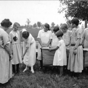 Demonstration by Miss Lois Sloop in measuring at local girls sewing club, September 11, 1923.