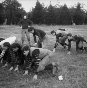 North Carolina College of Agriculture and Mechanic Arts football team lining up in formation on the practice field.