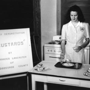 Frances Lancaster preparing custards for a dairy foods demonstration
