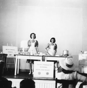 Two 4-H club girls performing a food preparation demonstration at North Carolina State 4-H Short Course at North Carolina State College in Raleigh