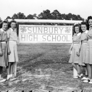 4-H Club girls standing in front of the Sunbury High School sign, a school project 1940-1941