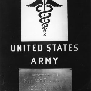Close-up view of a plaque placed on the side of an ambulance dedicated in honor of former 4-H club members who are serving in the armed forces