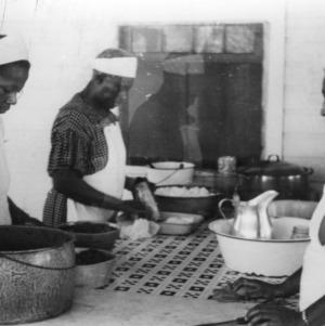 Cooks preparing food in kitchen at White Lake 4-H Camp