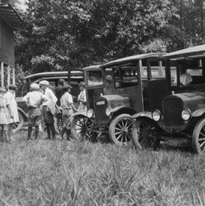 Children standing near cars at Lake Waccamaw encampment