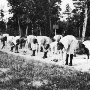 4-H club members performing bending exercises at a 4-H club camp in 1922