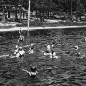 4-H club members swimming in a lake at a club camp