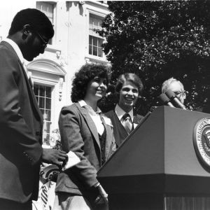At the White House, Conference Delegates present conference commemorative gifts to President Jimmy Carter