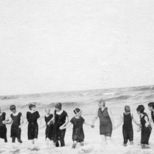 4-H club members playing in the ocean