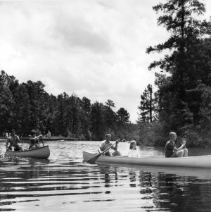 4-H club members go canoeing at a 4-H camp