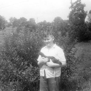 4-H club boy with chicken, Moore County, North Carolina, 1953