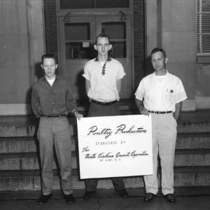 Left to right, Joe Ellis, James Cox, Henry Dameron, 4-H poultry production demonstration team, 1957