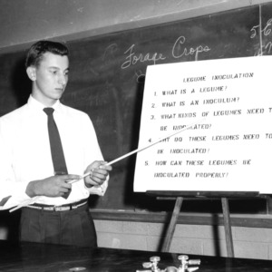 4-H club boy participates in North Carolina State 4-H demonstration competition, 1957