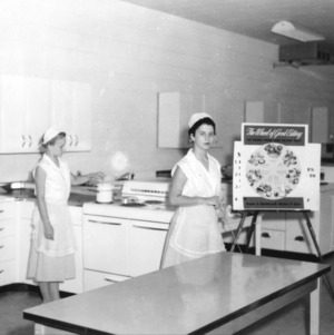 Ann White (left) and Lois Winslow (right) of Perquimans County, North Carolina, giving a 4-H food preparation demonstration on good nutrition