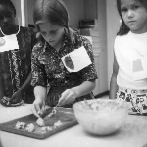 Three 4-H club girls making cookies as part of a 4-H food preparation program