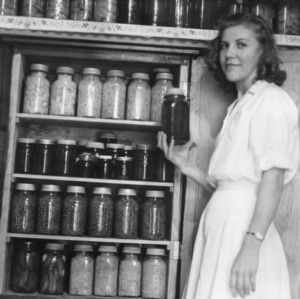 Florine Bivens, Anson County, Wadesboro, Rt. 2, shown with some of her canned products, conserved in a 4-H Club project
