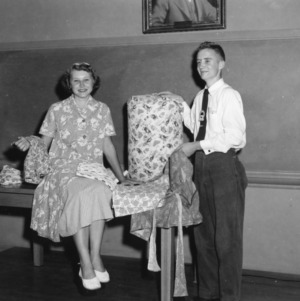 4-H club girl and boy displaying fabrics