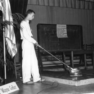 4-H club member performing a floor sanding demonstration