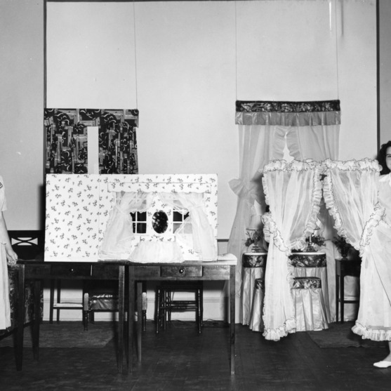 4-H girls performing a demonstration on curtains for the bedroom