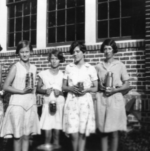 Five 4-H club girls, canning winners from the southeast 4-H district, May 29, 1931