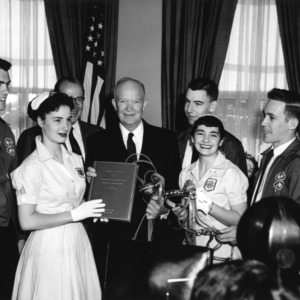 """National Champion 4-H'ers present """"Report to Nation"""" to President Dwight D. Eisenhower at National 4-H Club Week, 1957"""