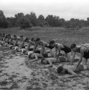 Lifesaving instructor teaching young men resuscitation at North Carolina State 4-H Short Course, 1932