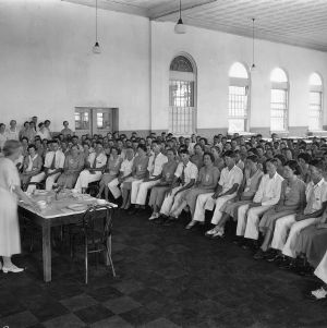 Instructor teaching large group of 4-H club members at North Carolina State 4-H Short Course, 1932