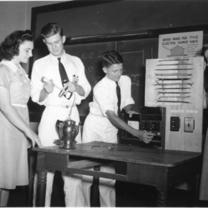 4-H club members examining electric components while attending North Carolina State 4-H Short Course at North Carolina State College, July 1941