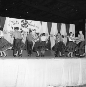 4-H club members dancing on stage for the fiftieth anniversary of 4-H while attending North Carolina State 4-H Club Week