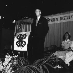 Speaker onstage during North Carolina State 4-H Club Week