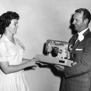 4-H club girl being presented with a sewing machine at North Carolina State 4-H Club Week held at North Carolina State College in Raleigh