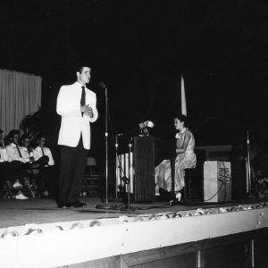 4-H club member speaking on a stage at North Carolina State 4-H Club Week