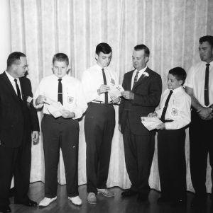 4-H club boys receiving awards at awards ceremony during North Carolina State 4-H Club Week