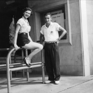 Woman and a man outside of Reynolds Coliseum during 4-H Club Week