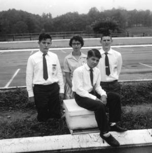 4-H club members posing in parking lot during North Carolina State 4-H Club Week