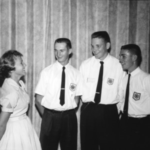 Young woman and four young men talking and laughing during North Carolina State 4-H Club Week