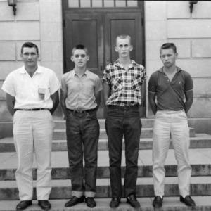 Four young men posing during North Carolina State 4-H Club Week